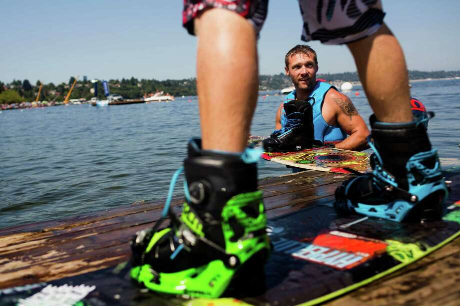 Wakeboarders near the Hyperlite booth chat before performing in front of a crowd. Photo: JORDAN STEAD, SEATTLEPI.COM / SEATTLEPI.COM