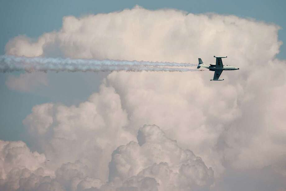 A Clay Lacy Lear 24 cuts through the clouds during the air show. Photo: JORDAN STEAD, SEATTLEPI.COM / SEATTLEPI.COM