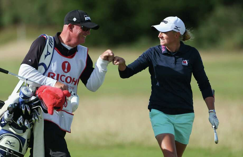 Stacy Lewis earns some praise from caddie Travis Wilson on the 17th hole during the final round of the Women's British Open. Her win ended a 10-major drought for Americans. Photo: Warren Little / Getty Images