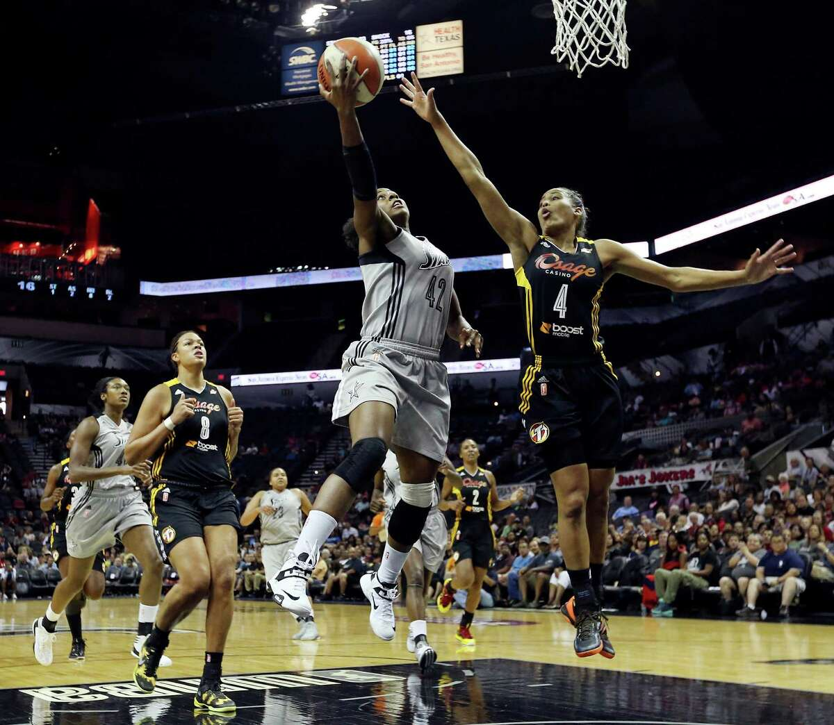 Silver Stars' Shenise Johnson shoots around Shock's Skylar Diggins during first half action Sunday Aug. 4, 2013 at the AT&T Center.