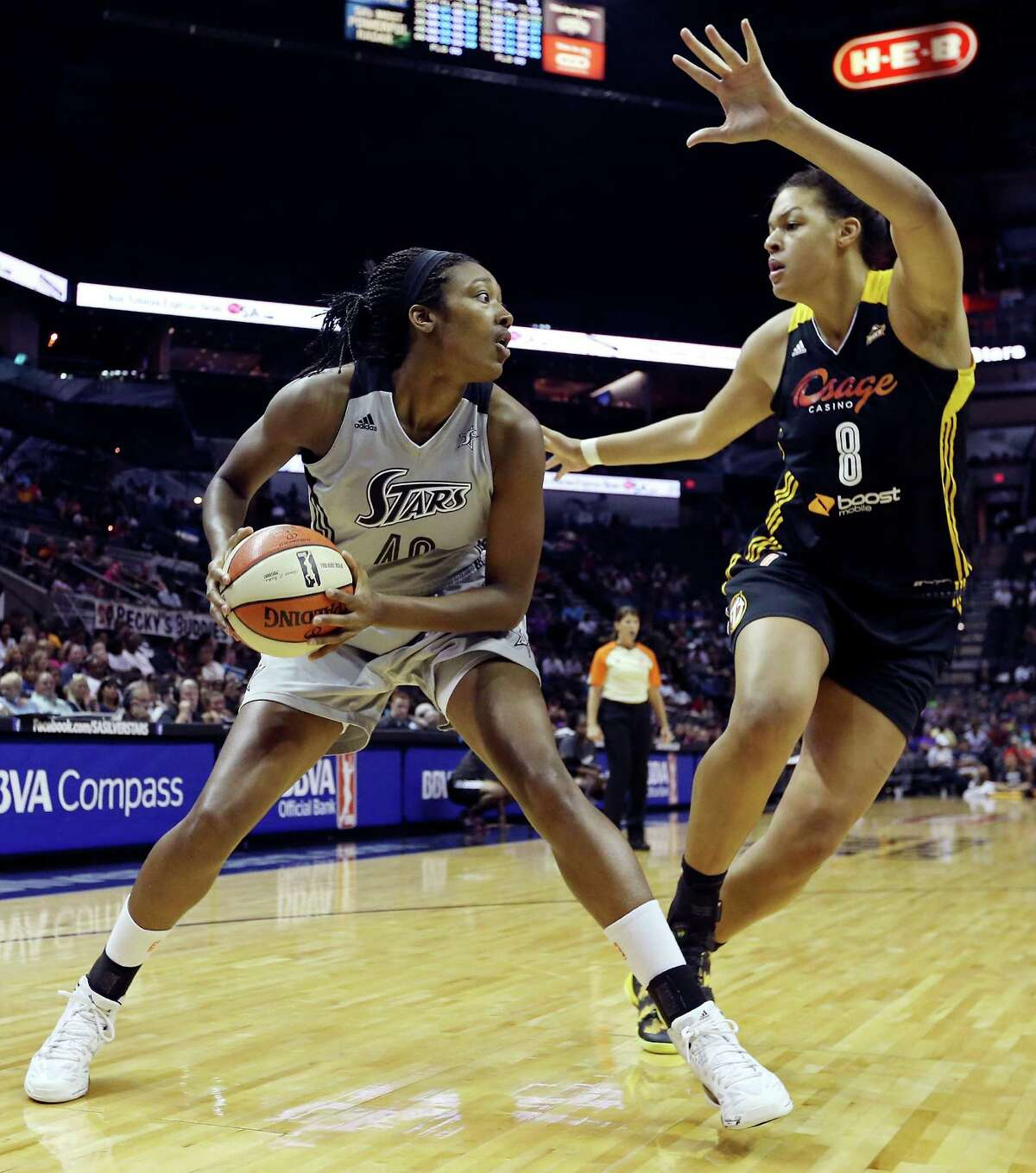 Silver Stars' Kayla Alexander looks for room around Shock's Elizabeth Cambage during first half action Sunday Aug. 4, 2013 at the AT&T Center.