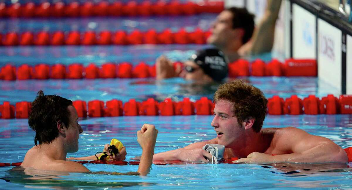US swimmer James Feigen (R) speaks with Australia's Cameron McEvoy after the heats of the men's 4x100-metre medley relay swimming event in the FINA World Championships at Palau Sant Jordi in Barcelona on August 4, 2013.