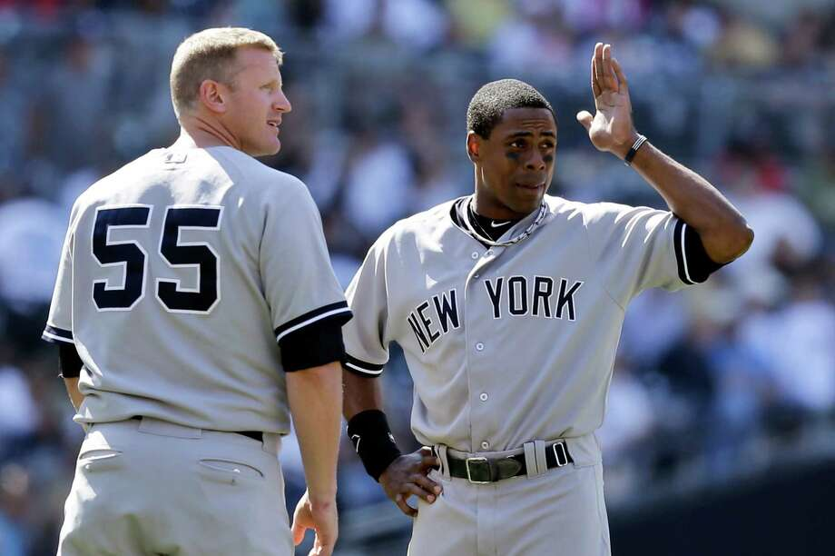 New York Yankees' Curtis Granderson, right, laments to teammate Lyle Overbay after Overbay made the final out of the eighth inning in the Yankees 6-3 loss to the San Diego Padres in a baseball game in San Diego, Sunday, Aug. 4, 2013. (AP Photo/Lenny Ignelzi) ORG XMIT: CALI120 Photo: Lenny Ignelzi / AP
