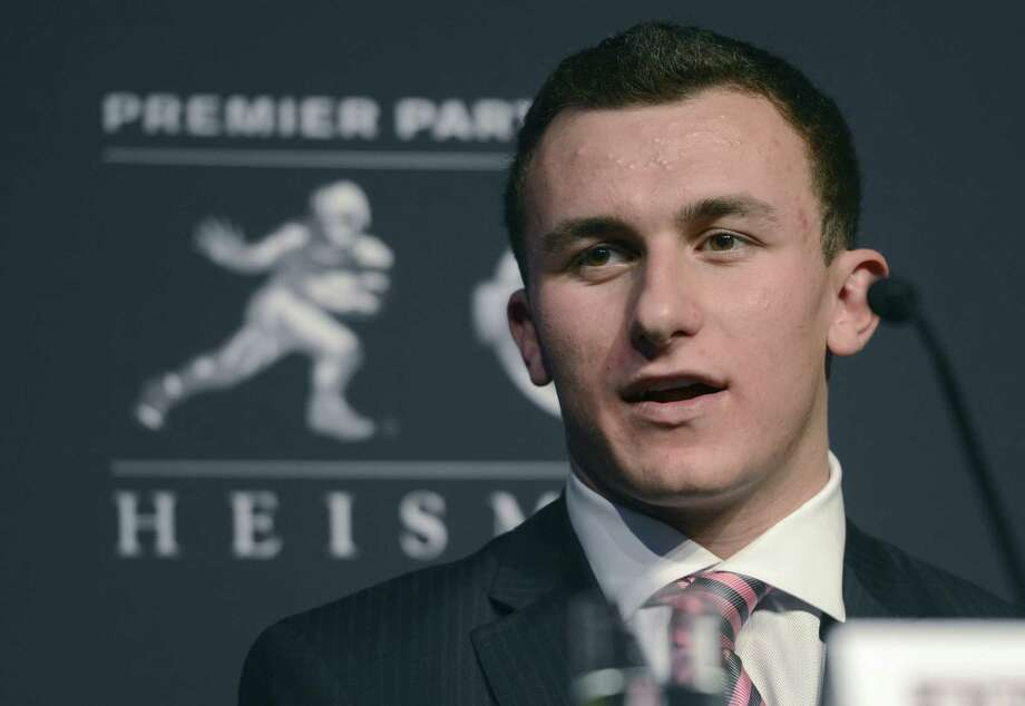 If the NCAA finds that A&M's Johnny Manziel took money for autographs, his eligibility could be in jeopardy. Photo: Associated Press File Photo