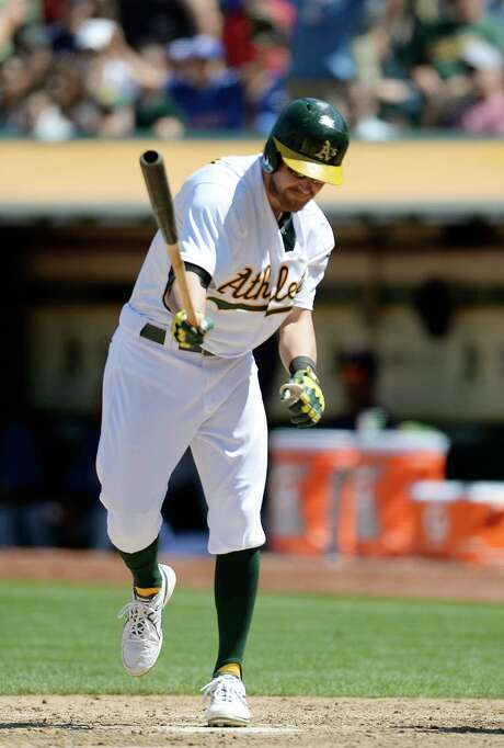 Oakland's Josh Reddick makes better contact with the ground than the baseball after becoming one of Derek Holland's 10 strikeout victims. Photo: Thearon W. Henderson, Stringer / 2013 Getty Images