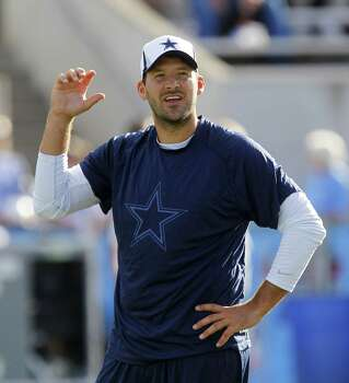 Tony Romo didn't see action at Fawcett Stadium, but he mentored Kyle Orton, Alex Tanney and Nick Stephens on Sunday. Photo: Rodger Mallison / Fort Worth Star-Telegram