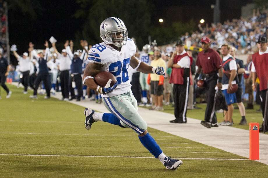 Running back Kendial Lawrence #28 of the Dallas Cowboys runs in a touchdown during the fourth quarter against the Miami Dolphins at Fawcett Stadium on August 4, 2013 in Canton, Ohio. The Cowboys defeated the Dolphins 24-20. (Jason Miller / Getty Images) Photo: Jason Miller, Getty Images
