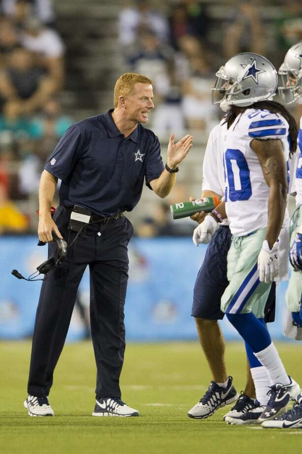 Head coach Jason Garrett of the Dallas Cowboys talks to his players as they come off the field during the fourth quarter against the Miami Dolphins at Fawcett Stadium on August 4, 2013 in Canton, Ohio. The Cowboys defeated the Dolphins 24-20. (Jason Miller / Getty Images) Photo: Jason Miller, Getty Images