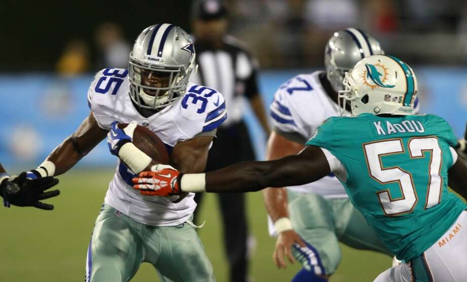 Dallas Cowboys running back Joseph Randle (35) runs past Miami Dolphins linebacker Josh Kaddu (57) for a gain of 10 yards in the third quarter at the Pro Football Hall of Fame exhibition football game Sunday, Aug. 4, 2013, in Canton, Ohio. (AP Photo/Scott R. Galvin) Photo: Scott R. Galvin, Associated Press
