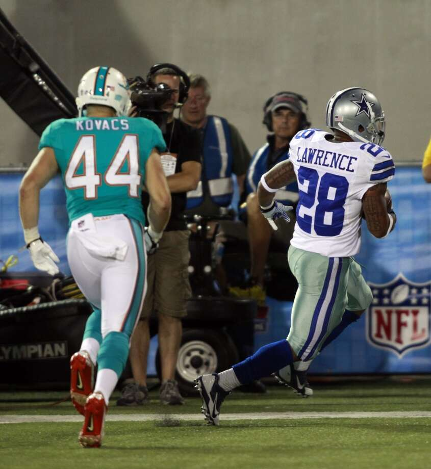 Dallas Cowboys running back Kendial Lawrence (28) scores a touchdown in the fourth quarter against the Miami Dolphins at the Pro Football Hall of Fame exhibition football game Sunday, Aug. 4, 2013, in Canton, Ohio. The Cowboys won 24-20. (AP Photo/Scott R. Galvin) Photo: Scott R. Galvin, Associated Press