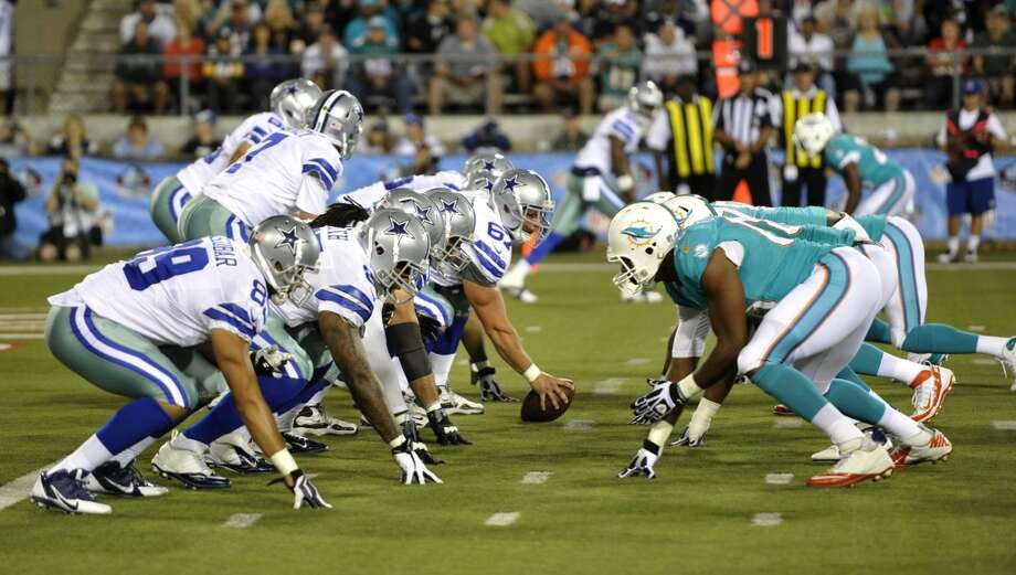 The Dallas Cowboys and the Miami Dolphins line up in the fourth quarter at the Pro Football Hall of Fame exhibition football game Sunday, Aug. 4, 2013, in Canton, Ohio. (AP Photo/David Richard) Photo: David Richard, Associated Press