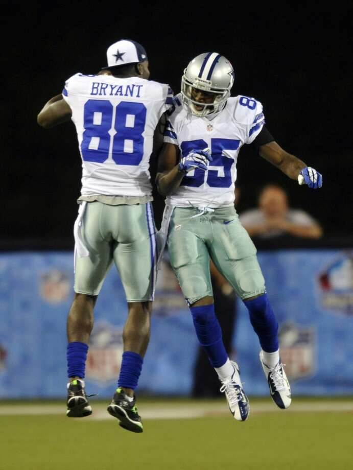 Dallas Cowboys' Jared Green (85) and Dez Bryant celebrate after Green caught a 32-yard pass in the fourth quarter at the Pro Football Hall of Fame exhibition football game, Sunday, Aug. 4, 2013, in Canton, Ohio. The Cowboys won 24-20. (AP Photo/David Richard) Photo: David Richard, Associated Press