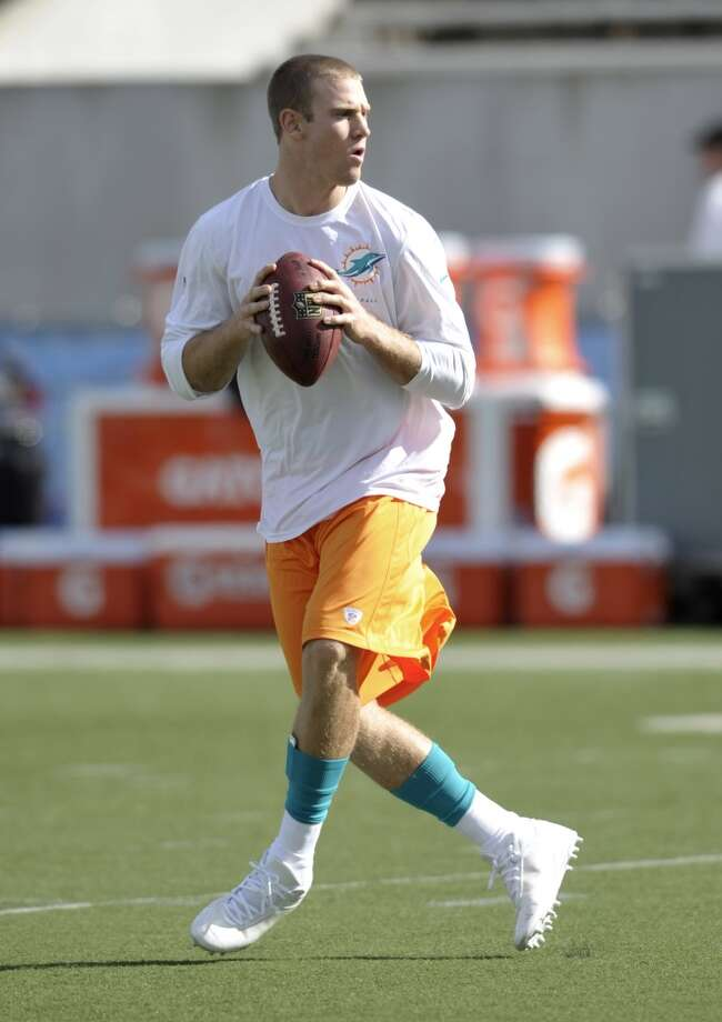 Miami Dolphins quarterback Ryan Tannehill warms up before the Dolphins play the Dallas Cowboys at the Pro Football Hall of Fame exhibition football game Sunday, Aug. 4, 2013, in Canton, Ohio. (AP Photo/David Richard) Photo: David Richard, Associated Press