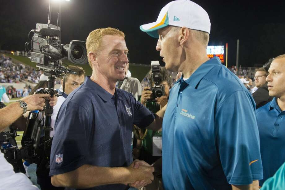 Head coach Jason Garrett of the Dallas Cowboys shakes hands with head coach Joe Philbin of the Miami Dolphins during the second quarter at Fawcett Stadium on August 4, 2013 in Canton, Ohio. The Cowboys defeated the Dolphins 24-20. (Jason Miller / Getty Images) Photo: Jason Miller, Getty Images