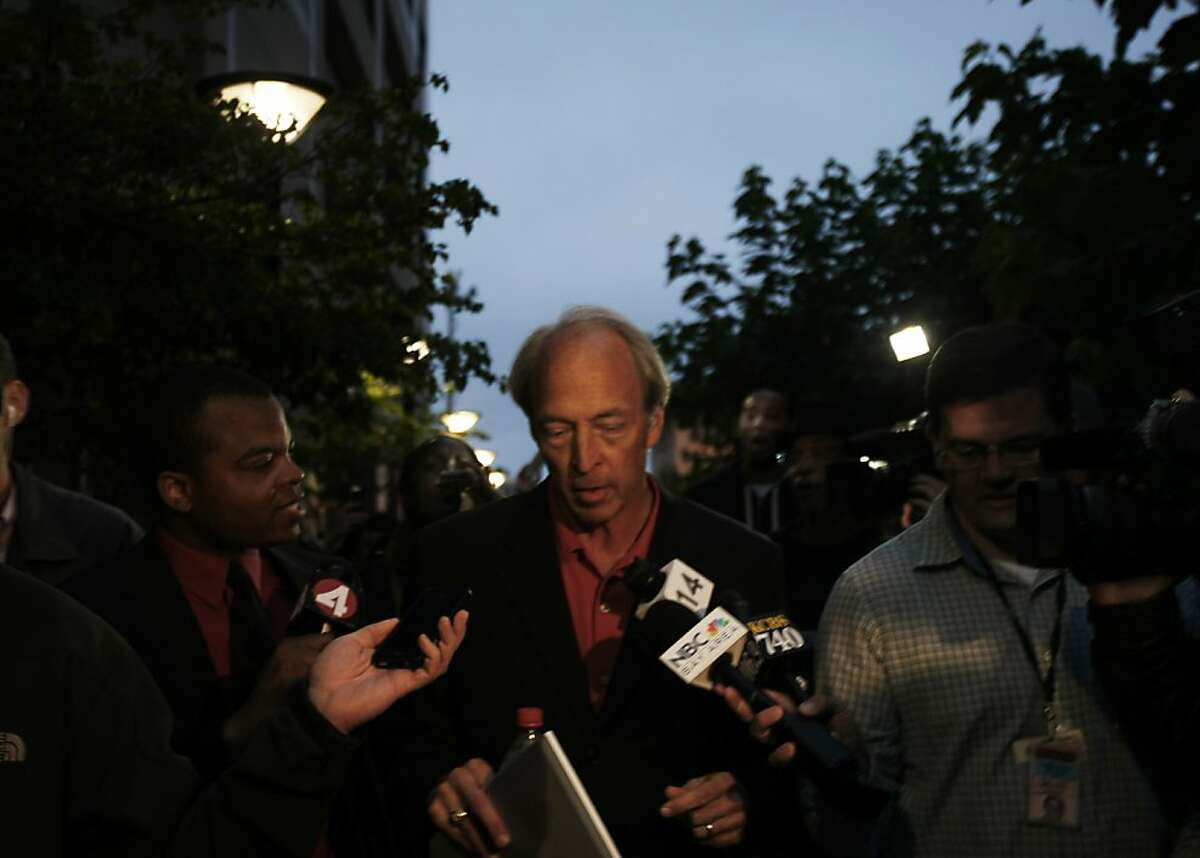 Lead negotiator for BART, Thomas Hock, leaves the Department of transportation building on Sunday, August 04, 2013 in Oakland, Calif. Hock implied that he was leaving briefly to talk with other people for 'more input.' A crowd followed Hock as he left the building shouting,