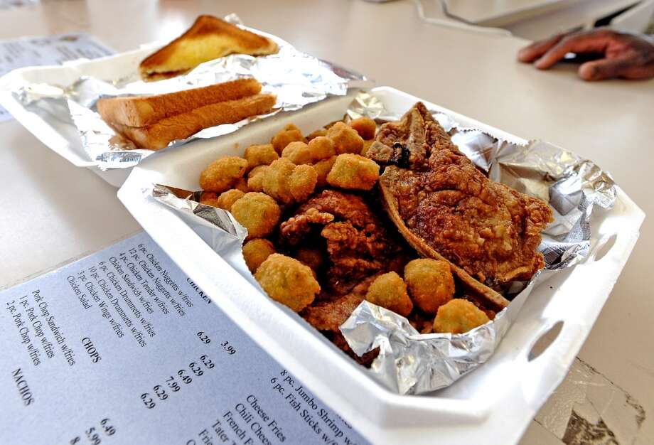The pork chop plate with a side of fried okra at  Coleman's Burger Deli the Cat5 restaurant of the week for August 1, 2013. Photo taken: Randy Edwards/The Enterprise