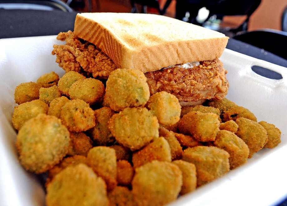 The pork chop sandwich plate erved with a side of fried okra at  Coleman's Burger Deli the Cat5 restaurant of the week for August 1, 2013. Photo taken: Randy Edwards/The Enterprise
