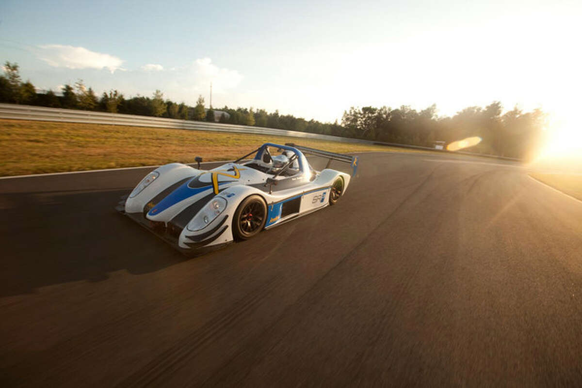 A Radical SR3 racecar. Because of the car's open-cockpit, drivers wear full-faced helmets and fire-resistant suits.