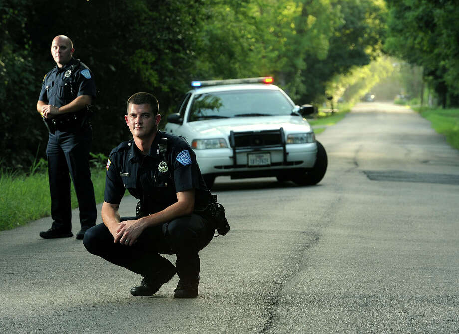 As seen on TV. From left, Matt Bean and Jason Schmoker are expected to be featured on the long-aired documentary series Cops after being filmed in a half-mile foot chase down Bennett Road. Photo taken Tuesday, July 30, 2013 Guiseppe Barranco/The Enterprise Photo: Guiseppe Barranco, STAFF PHOTOGRAPHER / The Beaumont Enterprise