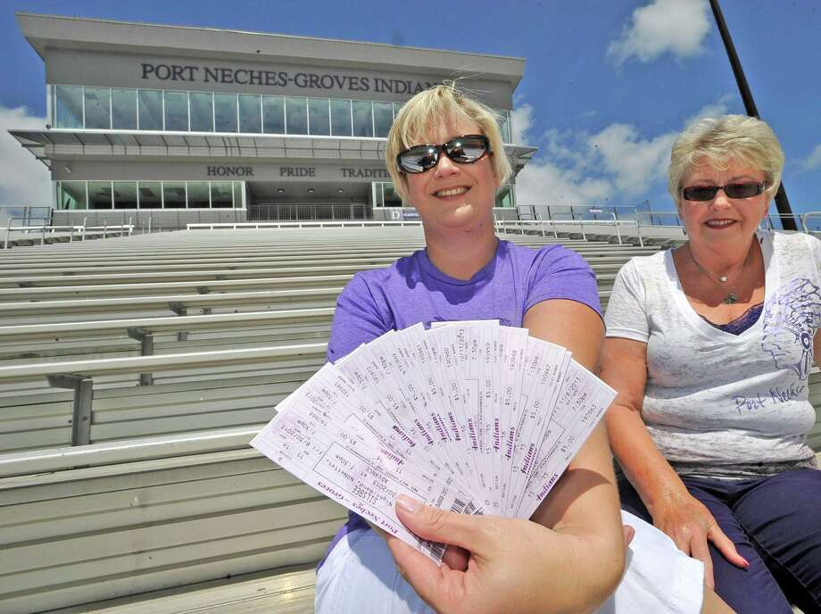 Jill Klinkhammer, left, is a Port Neches-Groves football season pass holder.  Their seats are high enough up to see over all the people and stuff on the sidelines and exactly in the center of the row, right on the 50 yard line.  Tickets have been in her family for over 60 years, having been passed down from her grandmother.  Her mother, Barbara Humphrey, right, is also a season ticket holder who had one set for 49 years and another set for 18 years.  Dave Ryan/The Enterprise Photo: Dave Ryan