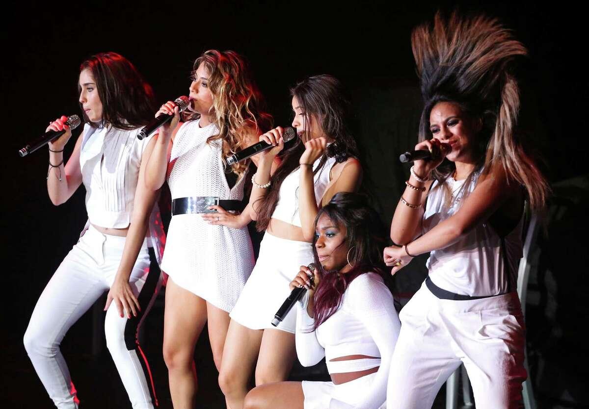 Fifth Harmony's Lauren Jauregui, (from left) Ally Brooke, Camila Cabello, Normani Hamilton, and Dinah Jane Hansen perform Friday July 25, 2014 at the Freeman Coliseum.