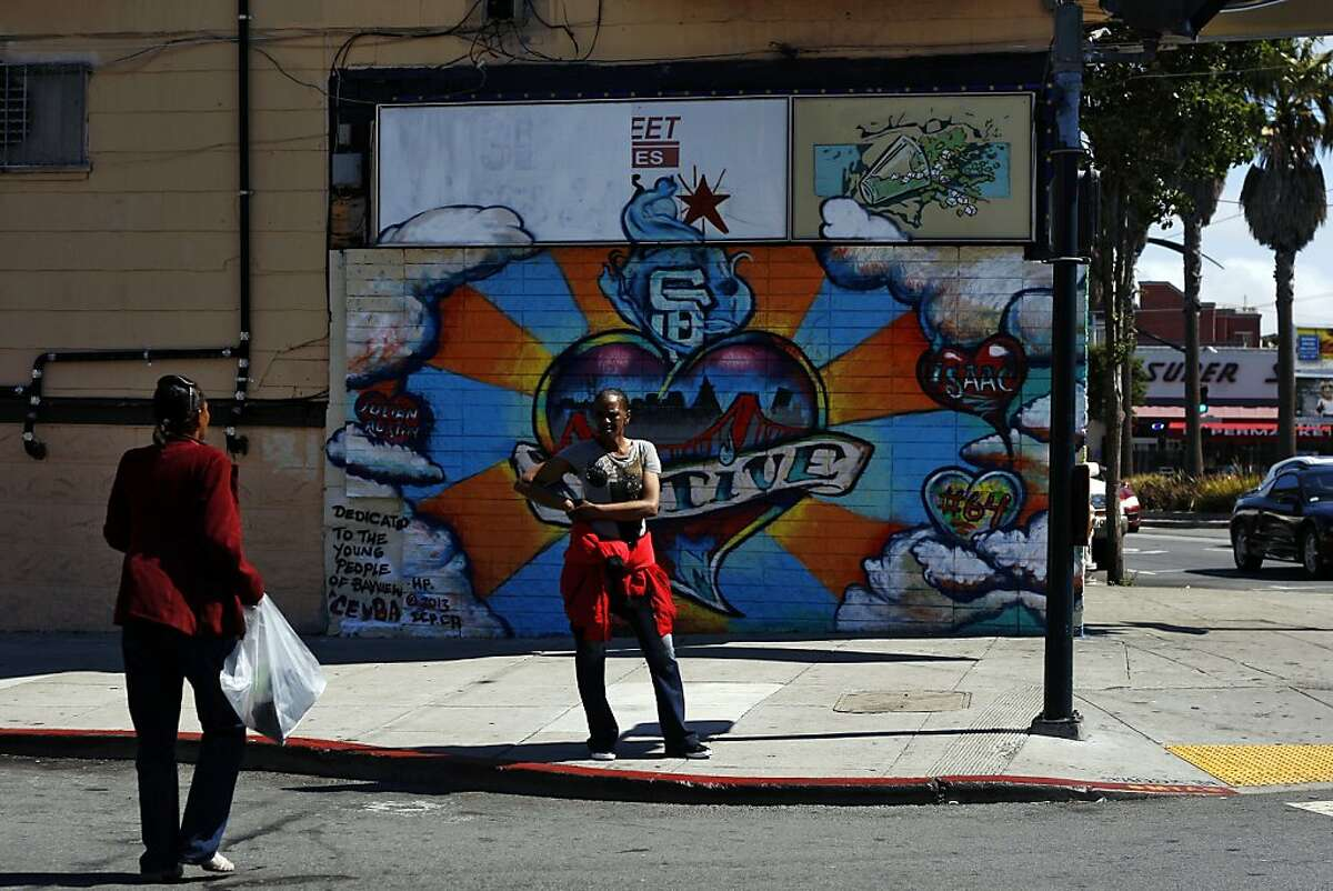 A woman (who preferred not to be named) stands on the corner of Newcomb and 3rd street in Bayview, a neighbourhood that is going through a number of changes at the moment on Friday, July 26, 2013 in San Francisco, Calif.