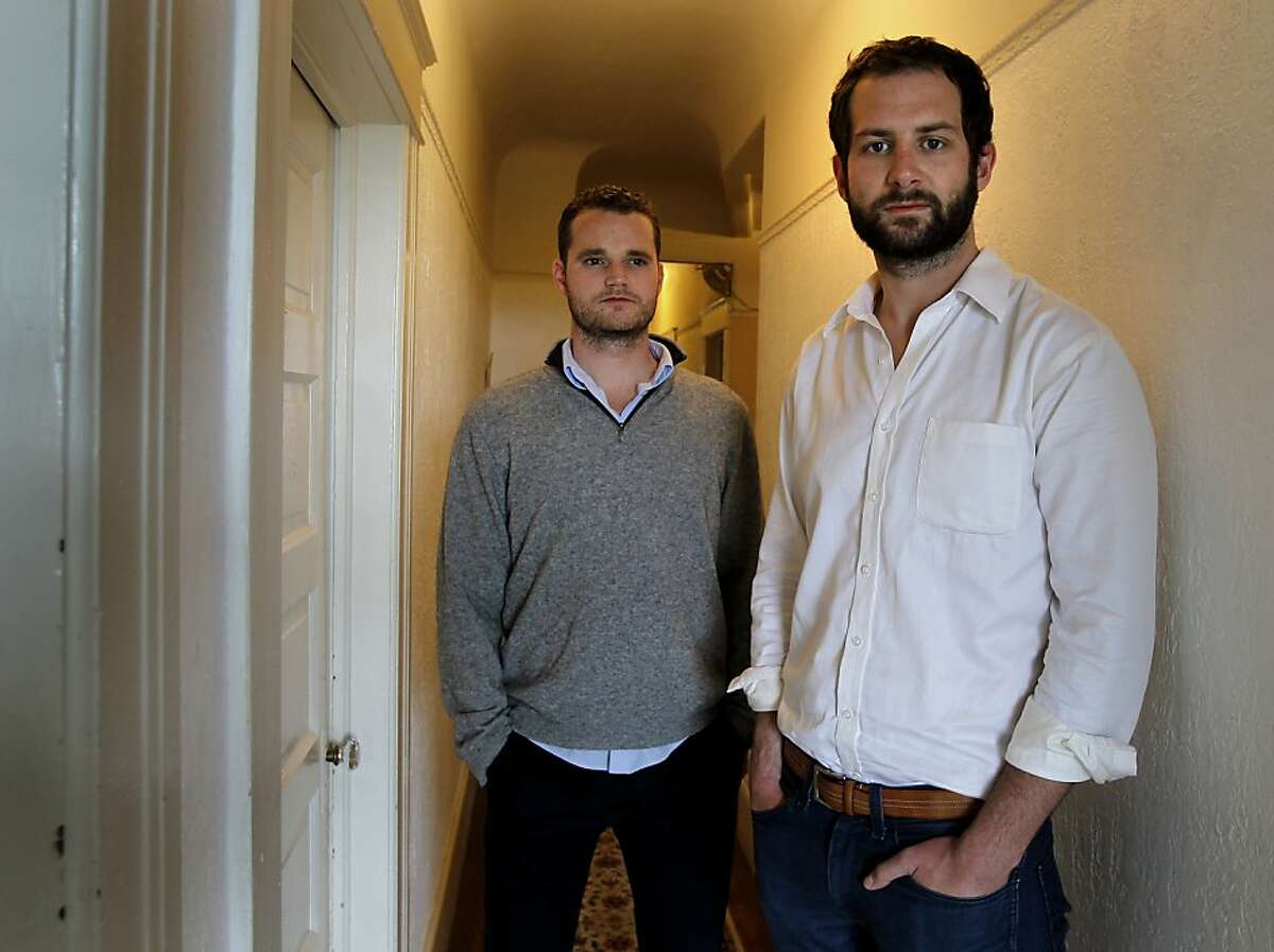Ian Johnstone (right) and Eric King in their San Francisco flat Sunday August 4, 2013. Ian Johnstone, who lost his father to gun violence, and Eric King are organizing one of the nation's first gun buybacks funded through crowd sourcing in San Francisco, Calif.