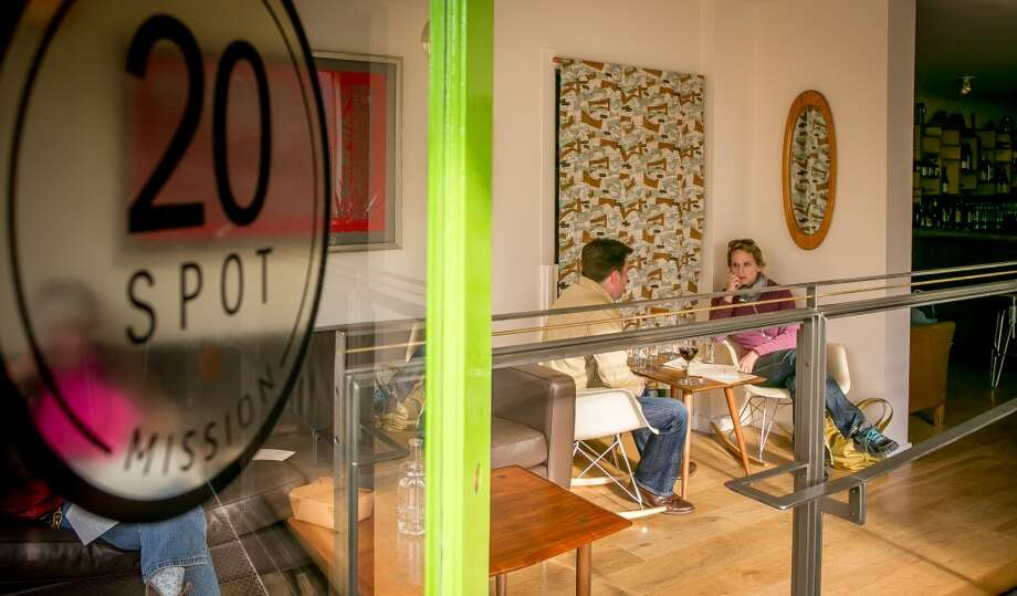 People enjoy food and wine at 20 Spot in San Francisco. Photo: John Storey, Special To The Chronicle