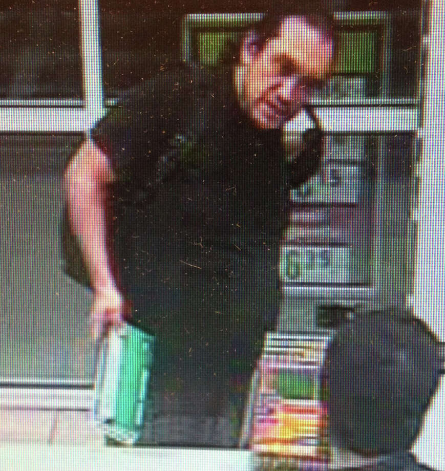 Police are looking for help in identifying this man who is suspected of breaking into a car on Cambridge Street last week. Photo: Contributed Photo / Fairfield Citizen