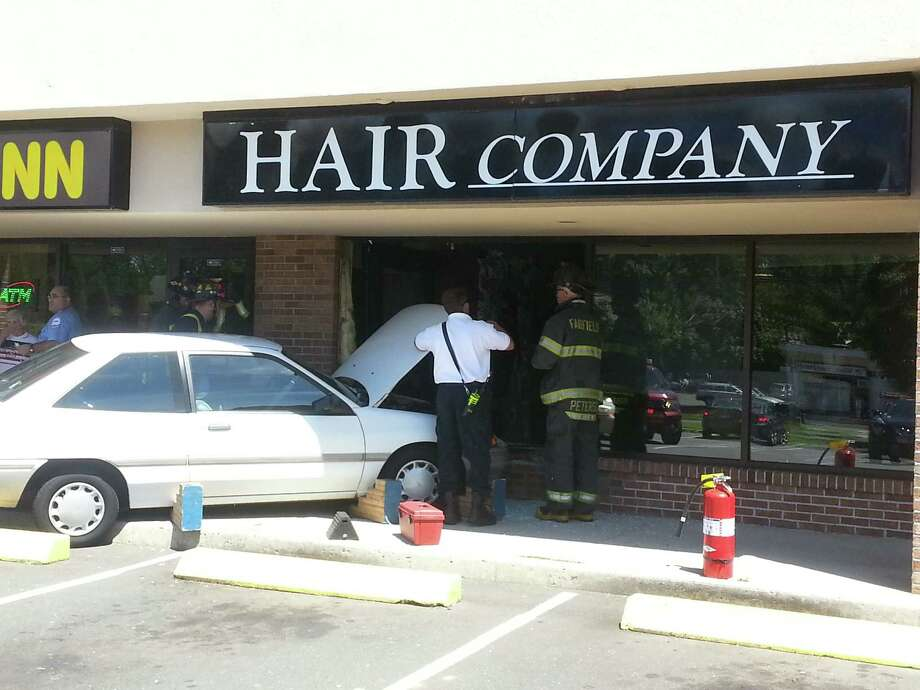 A car crashed into the Hair Company on Black Rock Turnpike on Monday, Aug. 5, 2013, jumping a curb and smashing the door and windows. Fortunately, the business is closed on Mondays. Photo: Doing It Local.com