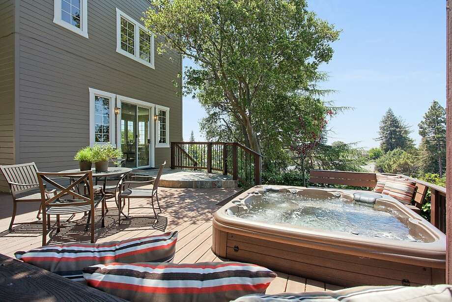 The backyard deck includes a hot tub and built-in stereo system. Photo: OpenHomesPhotography.com