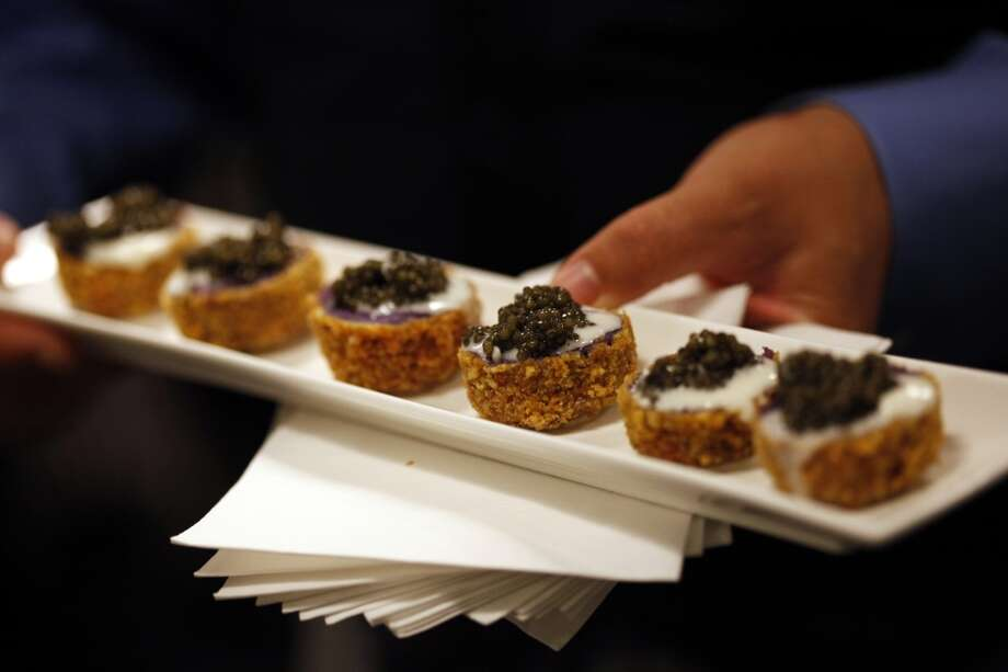 "Purple potato cakes with creme fraiche and caviar go out during cocktail hour at the ""Masters of Their Craft: Celebrating the Great Female Chefs and Sommeliers of San Francisco"" fundraising dinner. Photo: Sarah Rice, Special To The Chronicle"