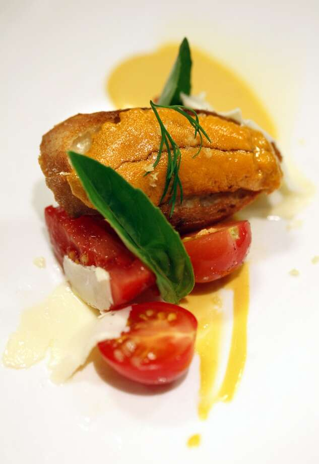 "Melissa Perello's dish: Garden tomatoes, Mendocino uni, toast and cultured butter at the ""Masters of Their Craft: Celebrating the Great Female Chefs and Sommeliers of San Francisco"" fundraising dinner. Photo: Sarah Rice, Special To The Chronicle"