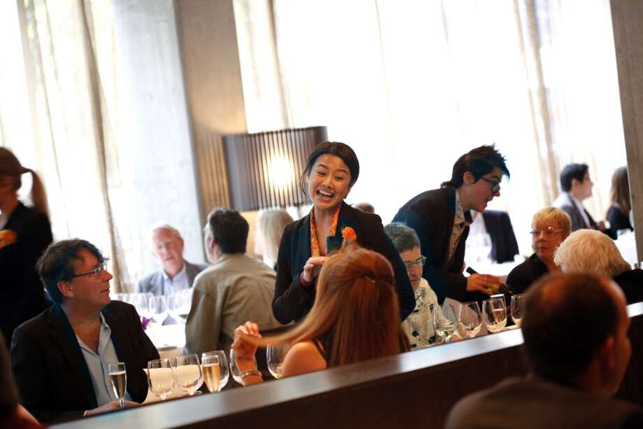 "Nissa Suteja, the sommelier at Acquerello, greets diners at the ""Masters of Their Craft: Celebrating the Great Female Chefs and Sommeliers of San Francisco"" fundraising dinner. Photo: Sarah Rice, Special To The Chronicle"