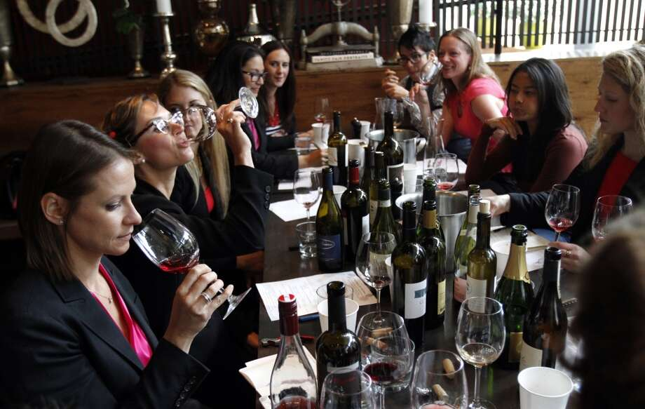 "Sommeliers taste the wine they will be serving before the ""Masters of Their Craft: Celebrating the Great Female Chefs and Sommeliers of San Francisco"" fundraising dinner. Photo: Sarah Rice, Special To The Chronicle"