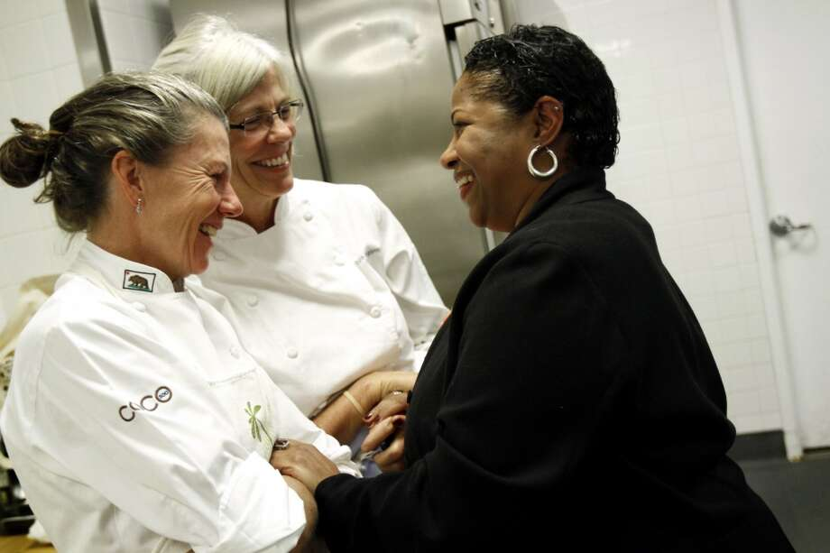 "Tonya Pitts, right, the wine director at One Market Restaurant, greets Loretta Keller, left, of COCO500, as friend Colleen McGlynn, center, looks on at the ""Masters of Their Craft: Celebrating the Great Female Chefs and Sommeliers of San Francisco"" fundraising dinner. Photo: Sarah Rice, Special To The Chronicle"