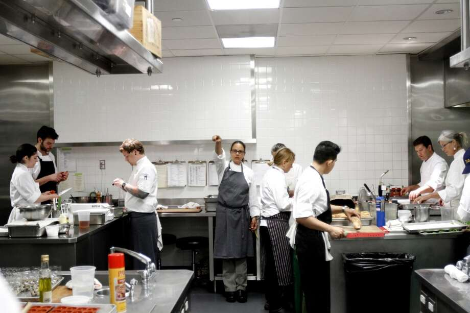 """Pamela Mazzola of Prospect, center, gives instructions at the """"Masters of Their Craft: Celebrating the Great Female Chefs and Sommeliers of San Francisco"""" fundraising dinner. Photo: Sarah Rice, Special To The Chronicle"""