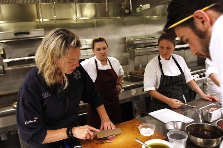 "Gayle Pirie, of Foreign Cinema, left, prepares her five spice duck breast at the ""Masters of Their Craft: Celebrating the Great Female Chefs and Sommeliers of San Francisco"" fundraising dinner. Photo: Sarah Rice, Special To The Chronicle"