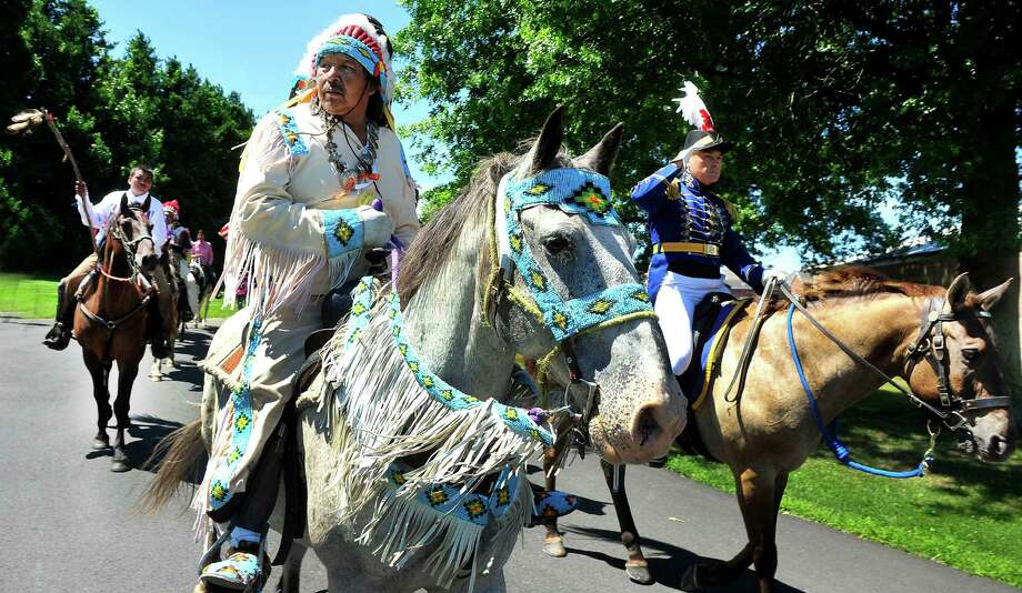 "Gus High Eagle, left, and Maj. Gordon Johnson lead the way as the riders of the Dakota Nation make a ceremonial ride through the gates of the ""fort"" with the Second Company Governer's Horse Guard in Newtown, Conn., as part of the Unity Ride, Monday, Aug. 5, 2013. Photo: Michael Duffy / The News-Times"