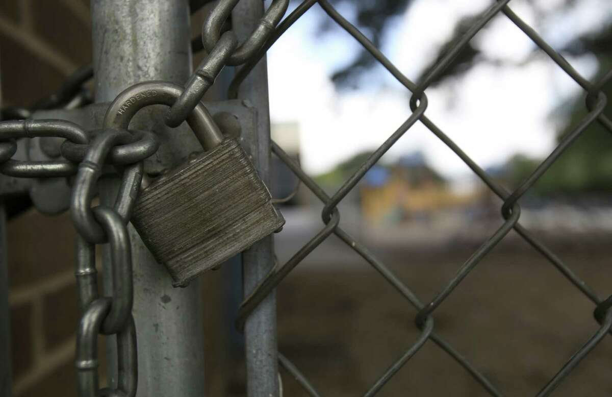 The playground at Howsman Elementary school in Northside ISD is locked. Research shows access to playgrounds, gyms or sports fields make kids more likely to become physically active and maintain a healthy weight.