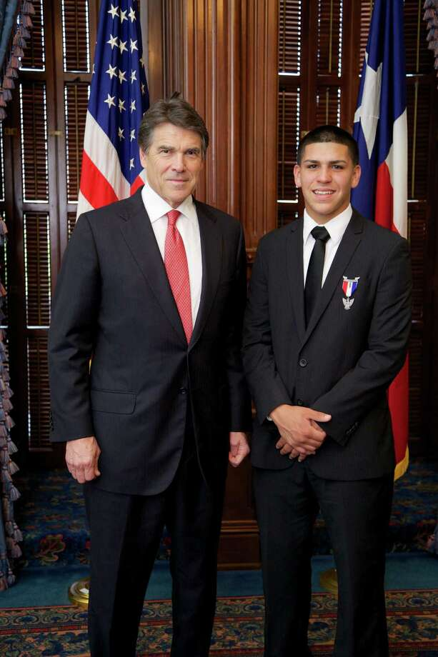 Nicolas Isaac Guerra, 16, right, who recently reached the rank of Eagle Scout, was congratulated by Texas Gov. Rick Perry.
