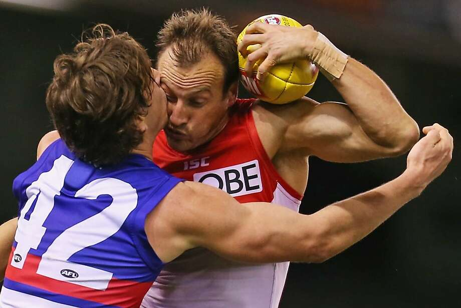 Jude, this isn't the time or place:Jude Bolton (left) of the Swans and Liam Picken of the Bulldogs clash in a round 19 AFL rugby match between the Western Bulldogs and the Sydney Swans at Etihad Stadium in Melbourne, Australia. Photo: Scott Barbour, Getty Images
