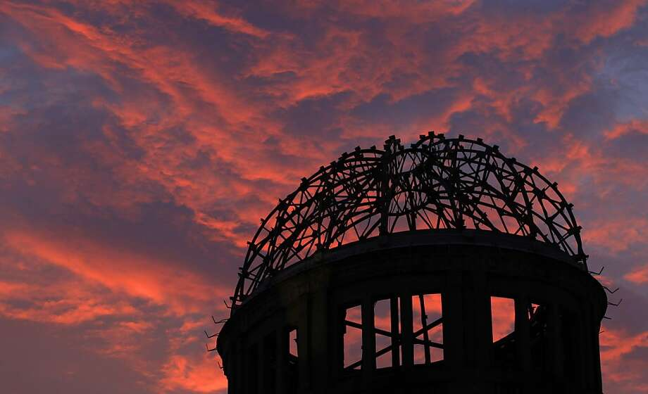 Sixty-eight years since the mushroom cloud:A brilliant sunset silhouettes the Atomic Bomb Dome in Hiroshima, Japan. Hiroshima 
