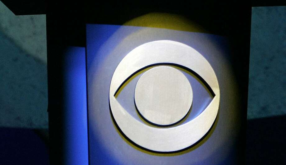 FILE - In this Jan. 9, 2007 file photo, a CBS Corp. logo is silhouetted in Las Vegas.  CBS reports its quarterly earnings on Wednesday, July 31, 2013. (AP Photo/Jae C. Hong, File) Photo: Jae C. Hong, Associated Press