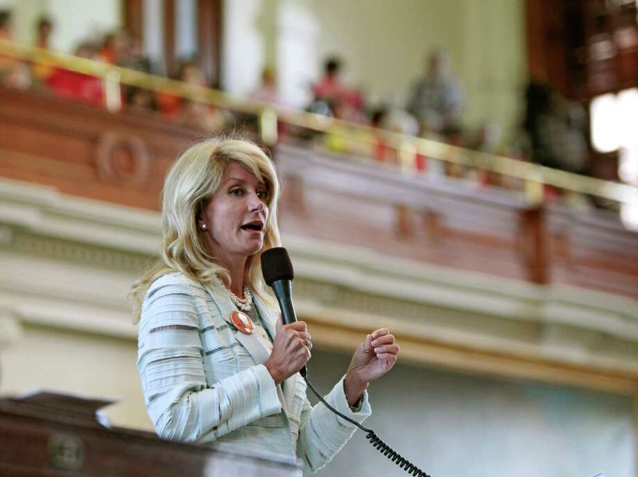 Texas State Sen. Wendy Davis, a Democrat, speaks during a filibuster intended to stop Senate Bill 5, which contains restrictions on abortions after 20 weeks, at the State Capitol in Austin, Texas, June 25, 2013. The State Senate, which passed a version of the bill last week without the 20 weeks ban, has until midnight Tuesday to take action on the bill. (Erich Schlegel/The New York Times) Photo: ERICH SCHLEGEL, STR / NYTNS