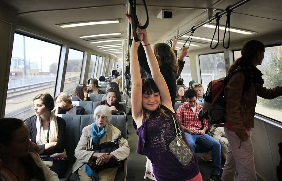 The day after Governor Jerry Brown intervened in the BART labor negations that posted a potential strike for at least another week,  Harleigh Huckin, 10, of Doyle, Calif, heads into the city for a day of sightseeing  on Monday Aug. 5, 2013 in Oakland, Calif. Photo: Mike Kepka, The Chronicle