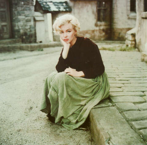Milton H. Green, Marilyn 'peasant' sitting on a curb, 1954. Photo: Milton H. Green, The Women's Museum / handout email