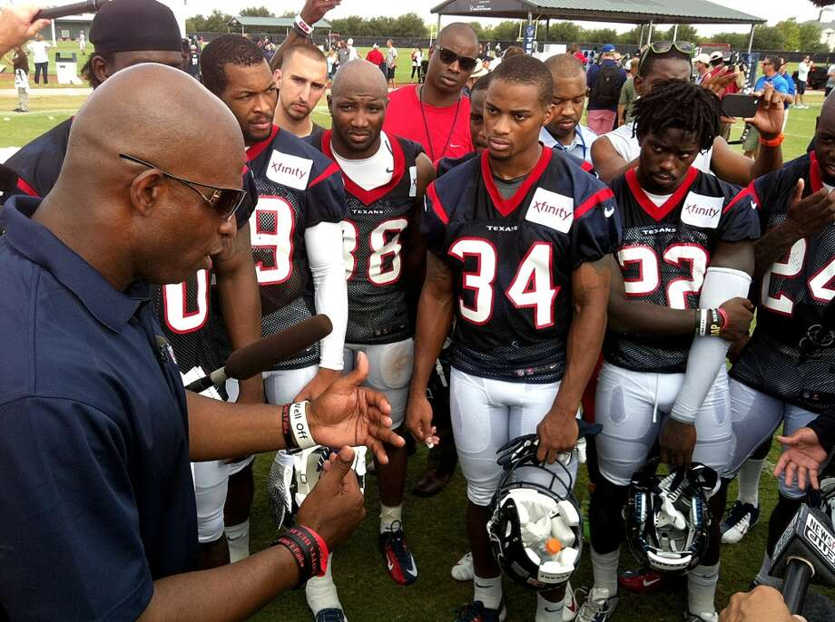 Hall of Fame defensive back Deion Sanders, left, talks to the Texans defensive backs after practice on Monday. Photo: Brett Coomer, Chronicle
