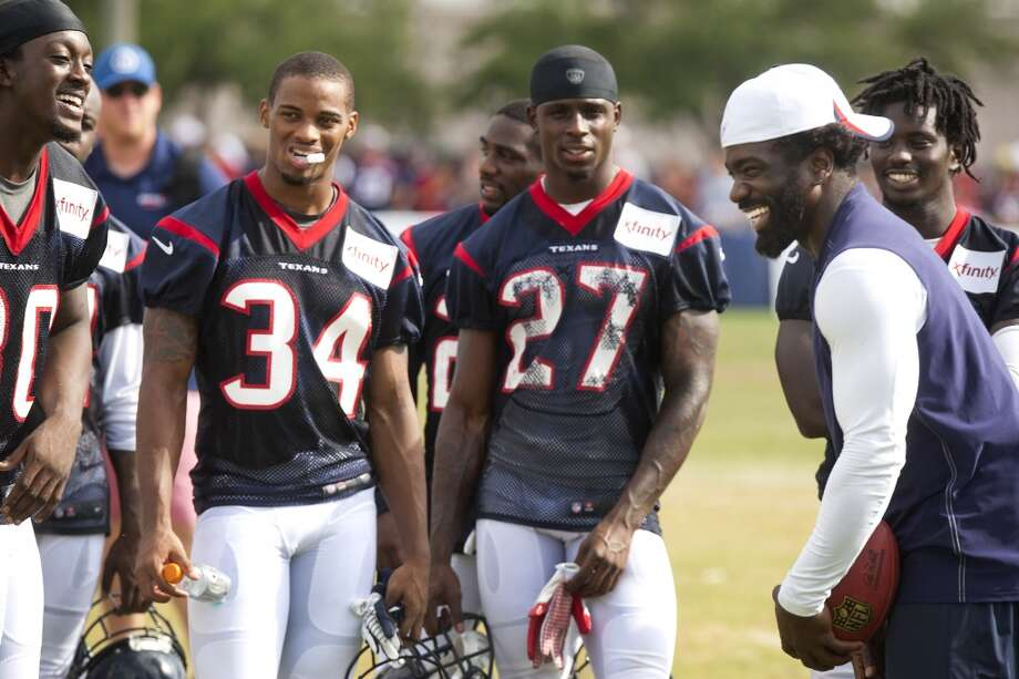 Free safety Ed Reed, right, shares a laugh with the defensive backs at the end of practice. Photo: Brett Coomer, Chronicle