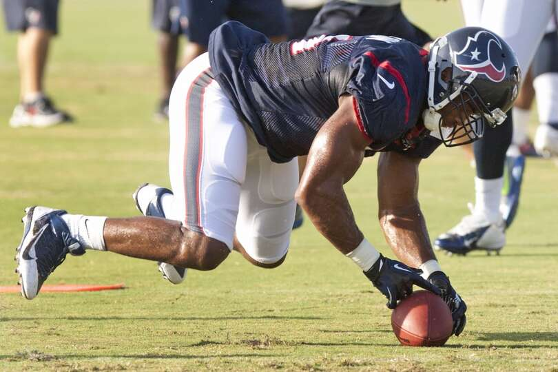Inside linebacker Darryl Sharpton dives on a loose ball during a turnover drill.